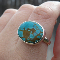 Pilot Mountain turquoise ring on hand