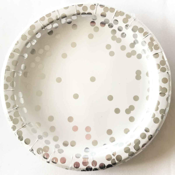 Confetti and silver paper party plates