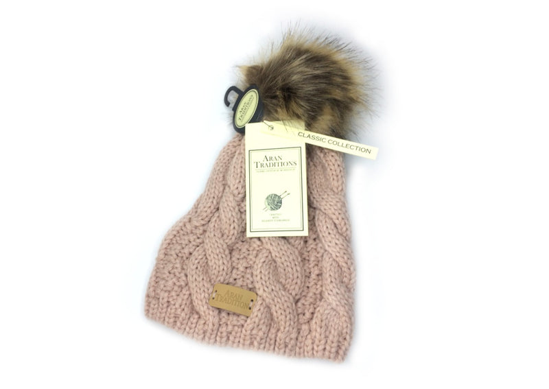 faux fur pom pom cable knitted beanie hat in the colour blush