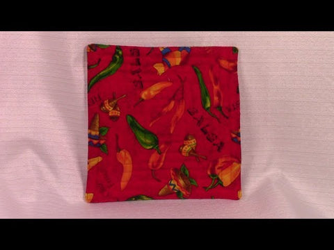 Easy Pot Holder: 2 fabric squares, cotton batting, very detailed sewing instructions, very quick project