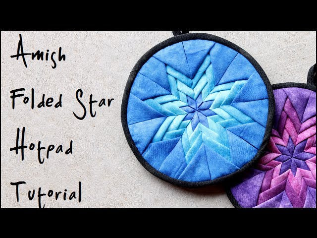 Learn how to make an Amish style folded star quilted hotpad! Or potholder if you prefer