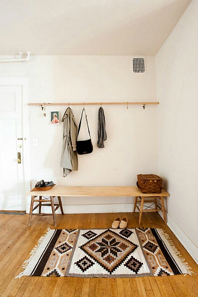When you have guests, what is the first thing they see when they walk through your front door? Is there a place to hang their coat? How about a spot to plop a purse?