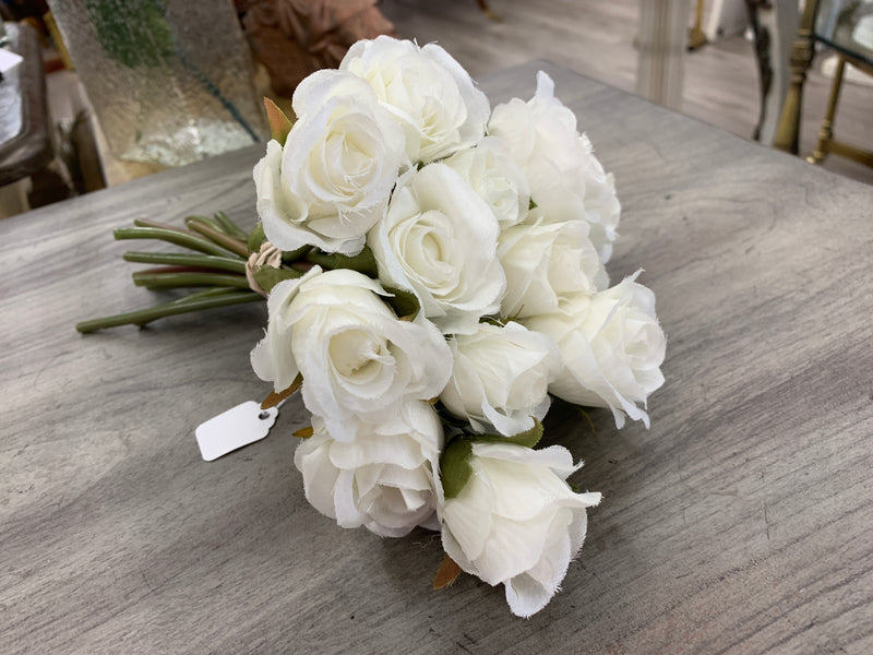 A bunch of white silk rose flowers