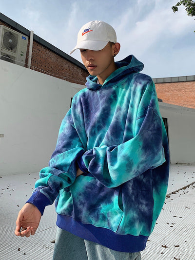 tie and dye hooded sweatshirt in blue and dark blue. The elastic wrists and hips are dark blue