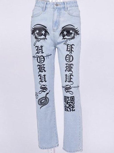 front view of our light blue jeans with two eyes at the top of the thighs, with gothic letters on the legs and snake, pentagram and qr code symbols in black