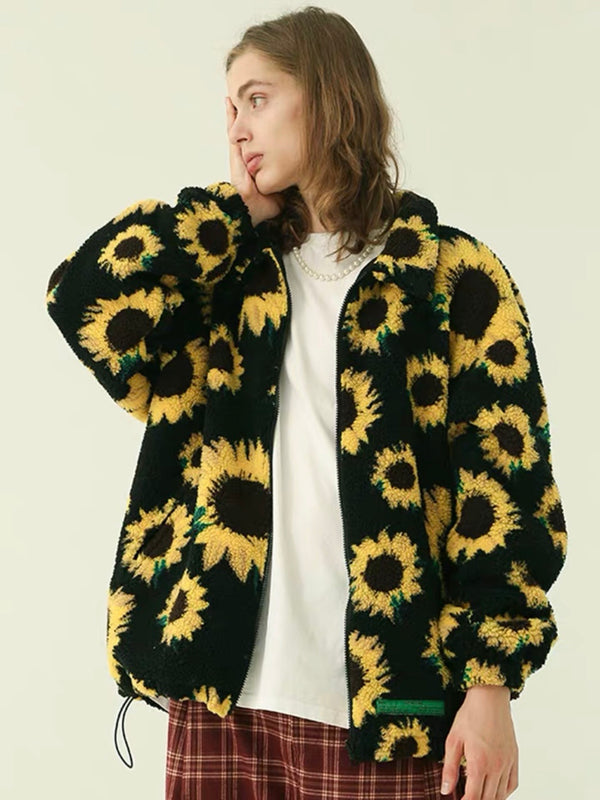 warm jacket with two front pockets and sunflowers printed on a plain black background that closes with a black zipper and adjustable by an elastic at the waist