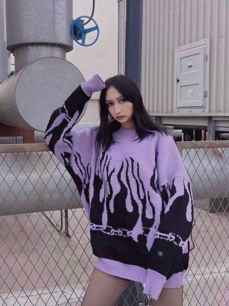 purple knitted sweater with black flames starting from the bottom of the sweater and the wrists worn by a woman