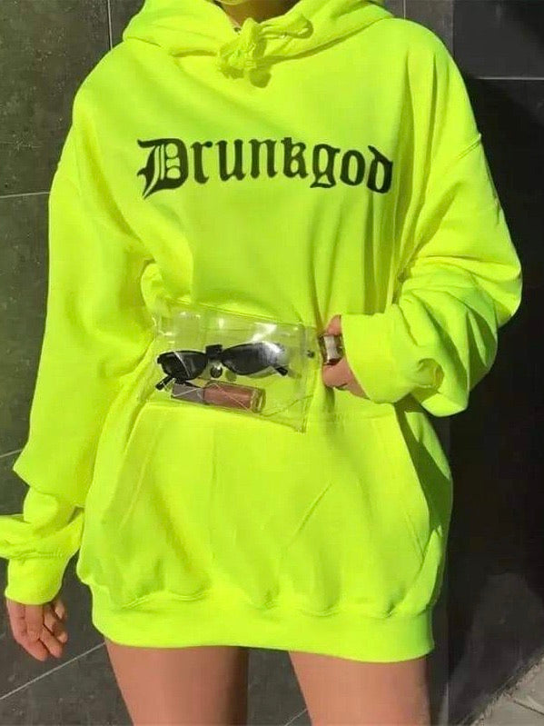 neon green hoodie with gothic letters which form the word drunkgod worn