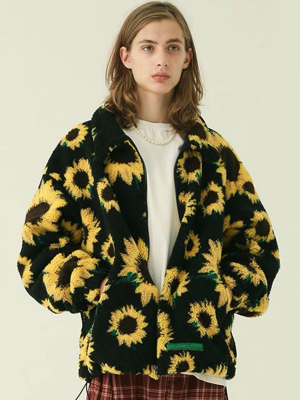 warm jacket with two front pockets and sunflowers printed on a plain black background worn