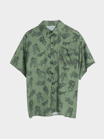 green shirt with black traditional patterns of dragon