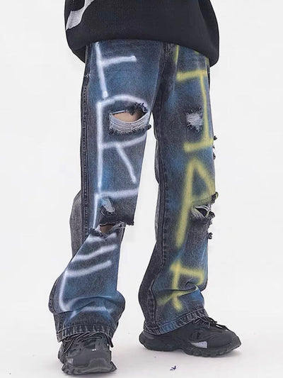 destroyed jeans with graffiti on legs dark blue