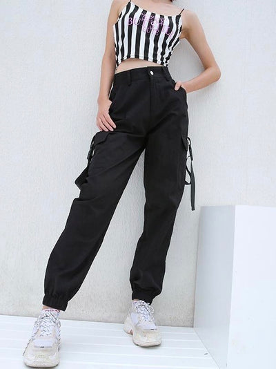 black high waist cargo pants with two big side pockets closed by a plastic buckle strap