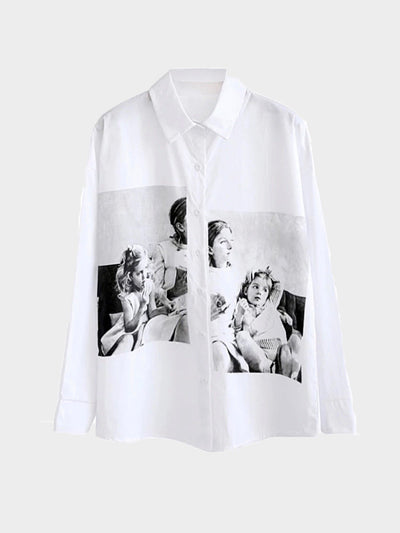 white shirt with a big picture printed in black and white split by the buttons that close the shirt of three girls