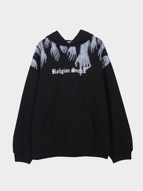 black hoodie with a front pocket, religion sucks written in white on the chest in gothic letters with x-ray hands leaving from the top of the sweater