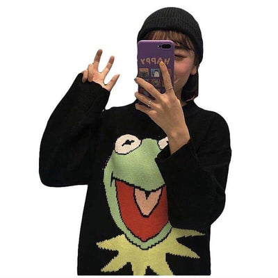 black knitted sweater with a big green smiling puppet frog