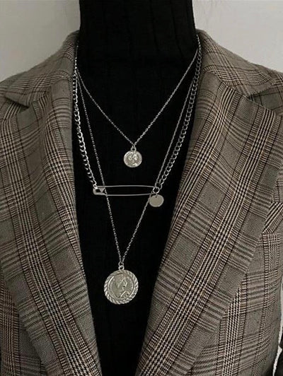 three layers necklace with two coins and one safety pin in silver