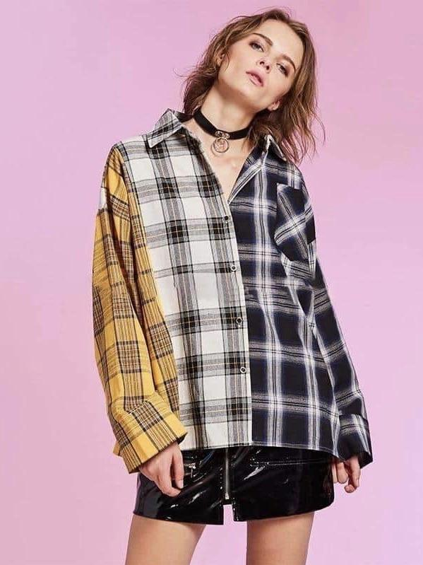 plaid blouse checkered in yellow for one panel, grey for the other and black for another one worn by a woman in one size