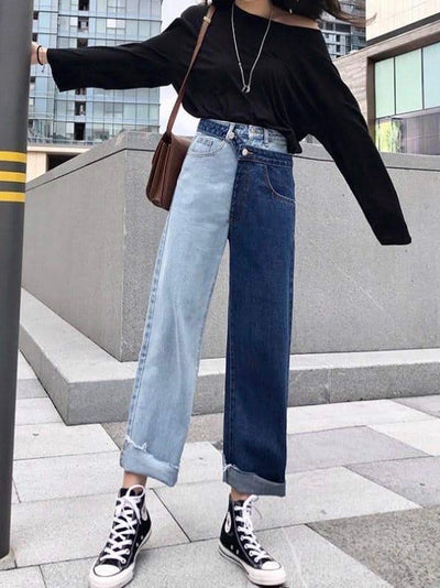 high waist bicolor jeans in light  blue and dark blue wearing by a woman
