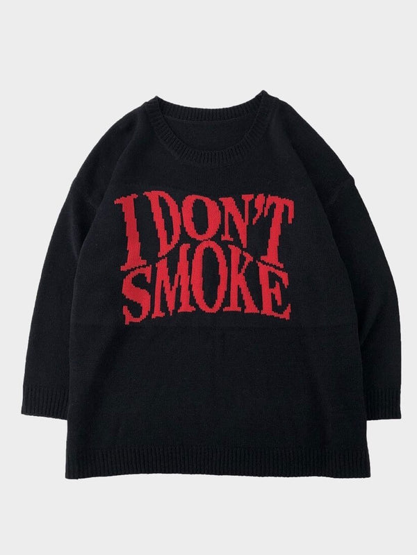 black knitter sweater with I don't smoke written in big red letters on the chest