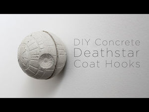I made this concrete deathstar coat hook using a ice cube mold filled with Quikrete countertop mix