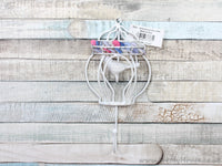 White metal bird cage coat hook