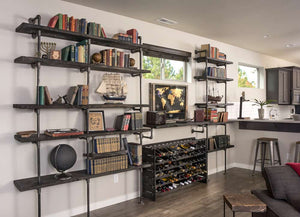 Learn how to build this impressive industrial pipe shelving the easy way! We've sourced the cheapest supplies for a pipe bookshelf if you're on a budget