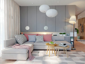 Sugar pink accents sweeten the soft grey interior of this modern family home, where layers of geometric pattern layer in interest and energy