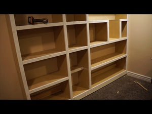 This is a built-in bookcase for the basement family room that is designed custom to fit the ceiling