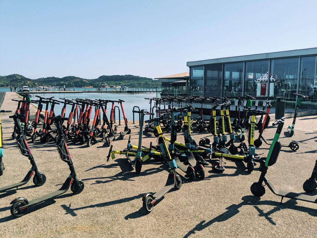 cluttered-shared-scooters-voi-wind-lime-bird
