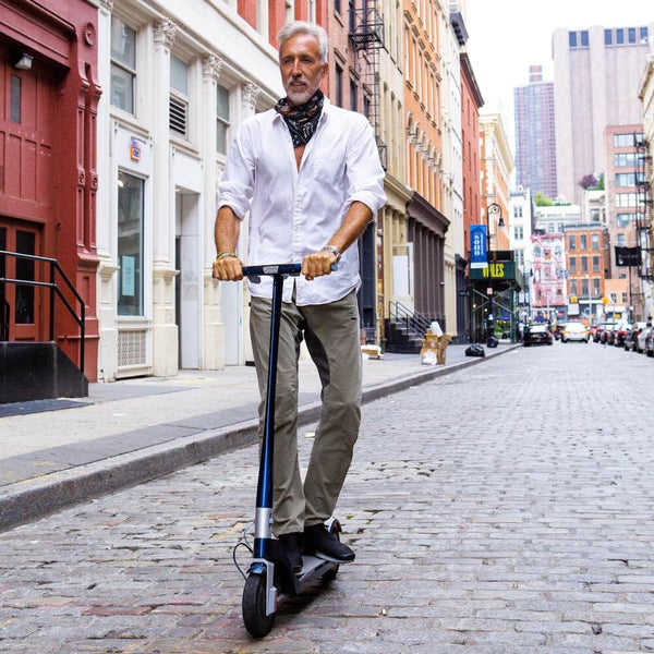elderly-white-male-unagi-scooter-rider