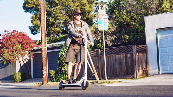 man-riding-electric-scooter