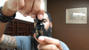 Man with beard holding a bottle of black beard brigade oil