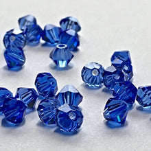 Load image into Gallery viewer, Swarovski Crystal Sapphire Bicone Beads, 4 mm, 34 Beads