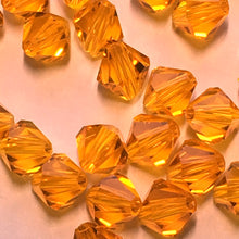 Load image into Gallery viewer, Swarovski Crystal Topaz Faceted Bicone Beads, 6 mm, 17 or 18 Beads