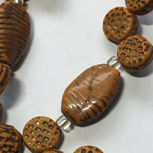 Load image into Gallery viewer, Beyond Beautiful Strand Amber Textured Glass Beads 10 mm (30) and 20 mm Oval Twist (8)