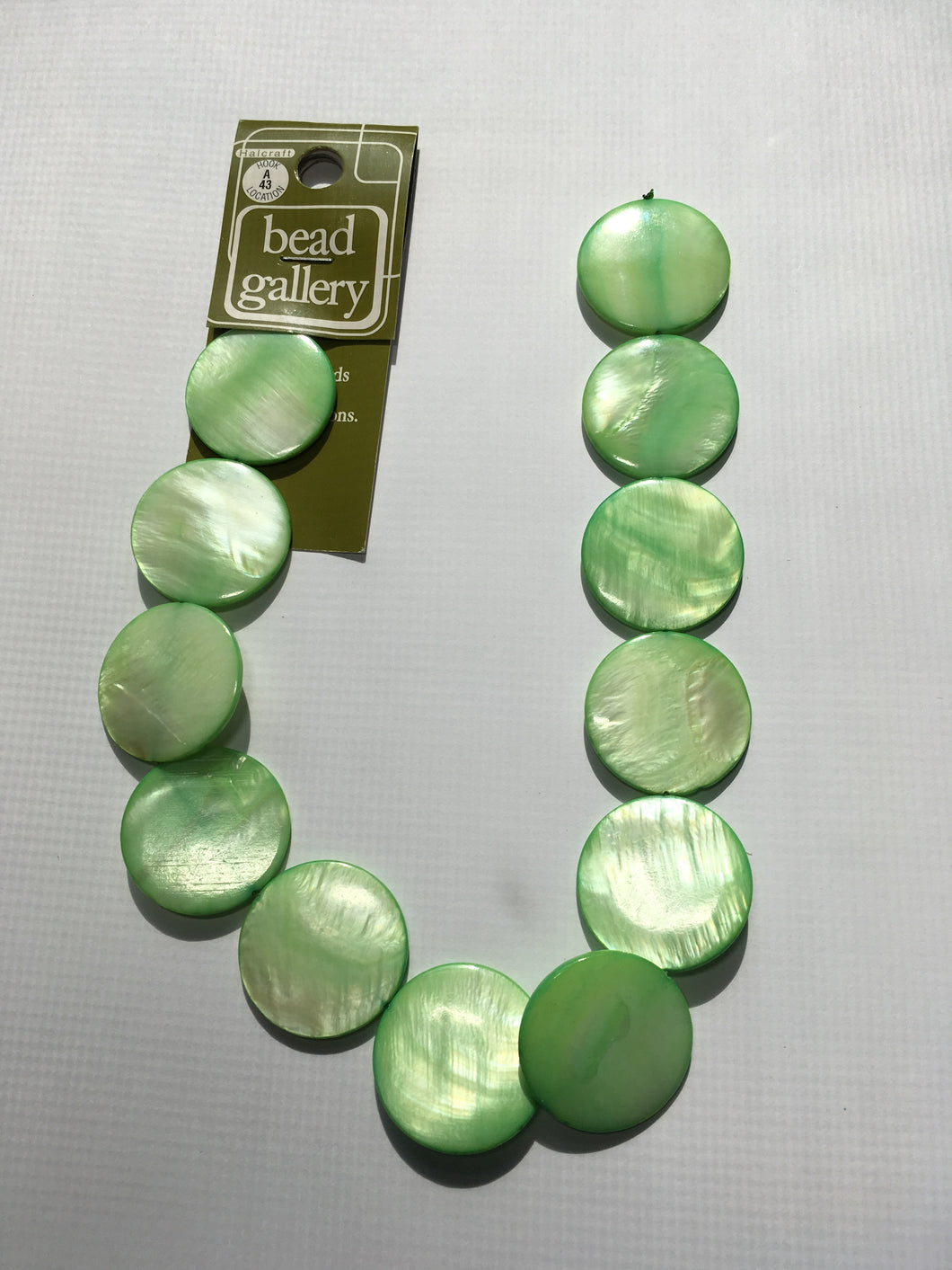 Bead Gallery Peridot Green Glass Lentil Beads, 25 mm, 12 Beads