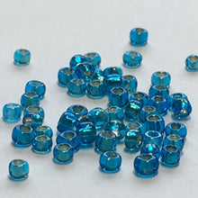 Load image into Gallery viewer, 11/0 Silver Lined Dark Aqua Seed Beads 5 gm