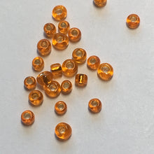 Load image into Gallery viewer, 11/0 Silver Lined Transparent Hyacinth Orange Seed Beads, 5 gm