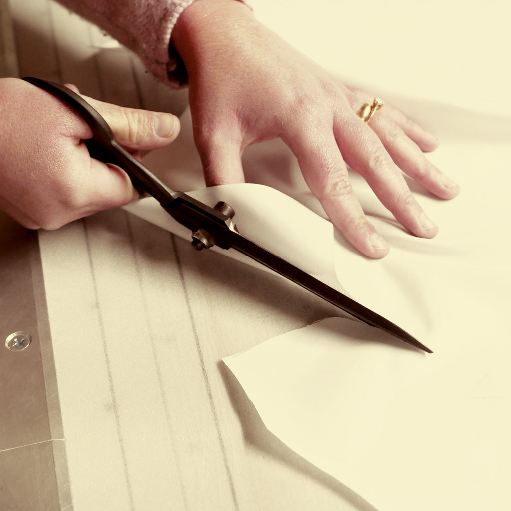 A Bespoke Shirt Being Cut By Hand