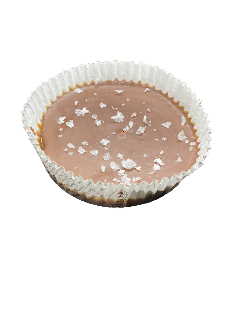 A picture of our Milk Chocolate Turtle Cup. A layer of fresh caramel, pecans and chocolate with a sprinkle of sea salt.