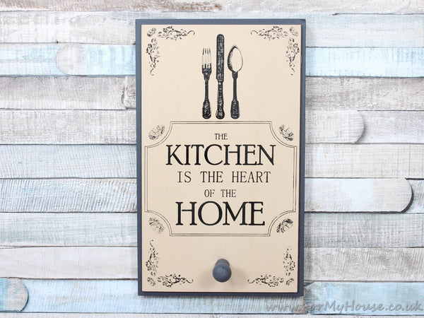 Kitchen is the heart of the home grey/cream apron coat hook