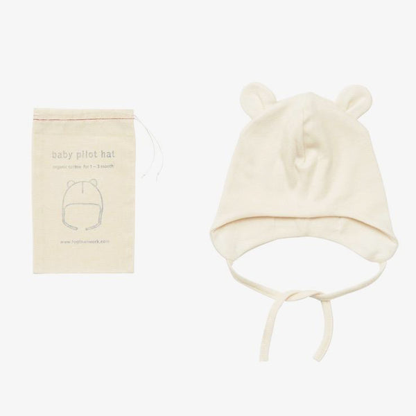 Fog Linen Baby Pilot Hat. Super-soft, organic cotton pilot hat. Perfect for the newborn or little aviator in your life. Packaged in muslin pouch as shown. 0-3 months100% organic cottonmachine wash gentle/dry cool or line-dry