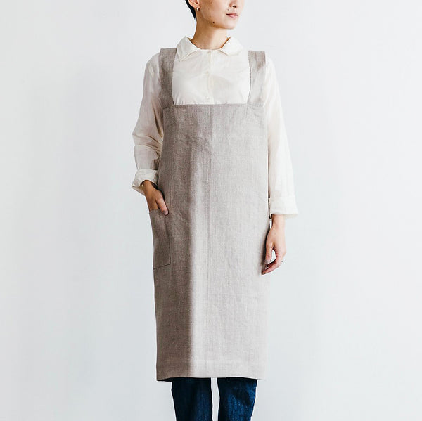 Fog Linen Natural Mid-length apron. Easy to wear, pull over cross apron made of natural linen. One pocket. Mid-knee length.