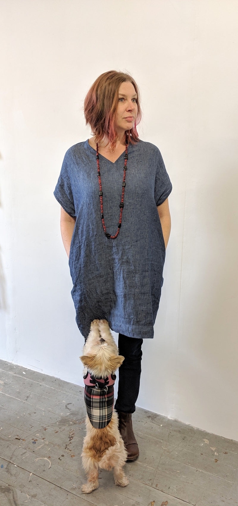 Simple, comfortable, indigo denim v-neck shift dress made of 100% medium weight European linen, prewashed. 2 pockets in side seams.