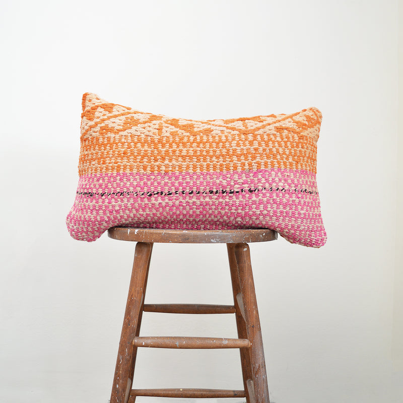 Made of vintage Peruvian blankets, these 100% wool pillows will add a pop of color to your living room. Buy a pair or mix and match for an eclectic touch. Each pillow is unique as it is cut from a vintage, handwoven blanket. Organic dyes. Size: 12 x 20