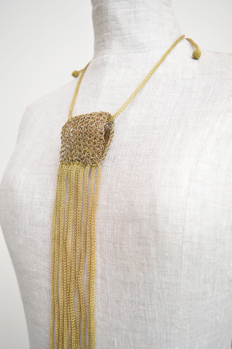 "Lotta Djossou gold wire statement necklace - This unique wire necklace is handcrafted by artisans in the island of Sumba in eastern Indonesia. Their wire wrapping technique produces delicate and timeless pieces that add a touch of sophistication to any look. Length 20"" Indonesia"