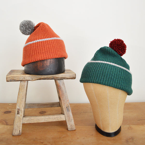 Catherine Tough winter hat. These soft, 100% Merino Wool hats are expertly knitted and hand finished with a thick, fluffy pompom. Guaranteed to keep you cosy and look great through the worst of weather with a fun pop of color! Made in Scotland. 100% pure New Wool. Hand wash.