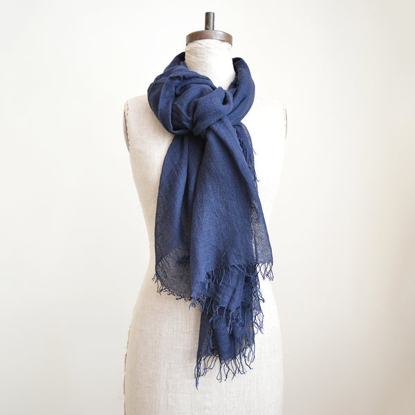 You can never have too many of Chan Luu cashmere and silk scarves. Super soft and lightweight - perfect to wear year round. This one is rich, dark, navy blue. Made of high quality Mongolian cashmere. Fringe trim along the edge. The perfect gift or treat for yourself!  70% cashmere 30% silk