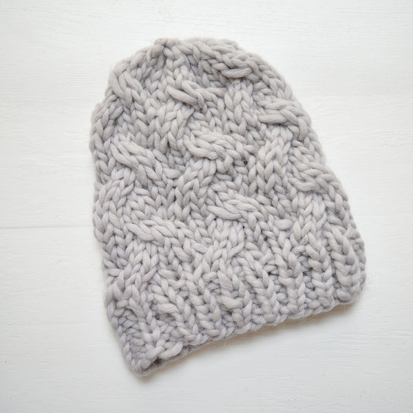 Cozy and warm hand-knit hats made from 100% merino wool in a lovely cable knit pattern. An essential fall accessory in understated, classic colors. Perfect for the coldest weather or makes for a lovely holiday gift for anyone on your list!