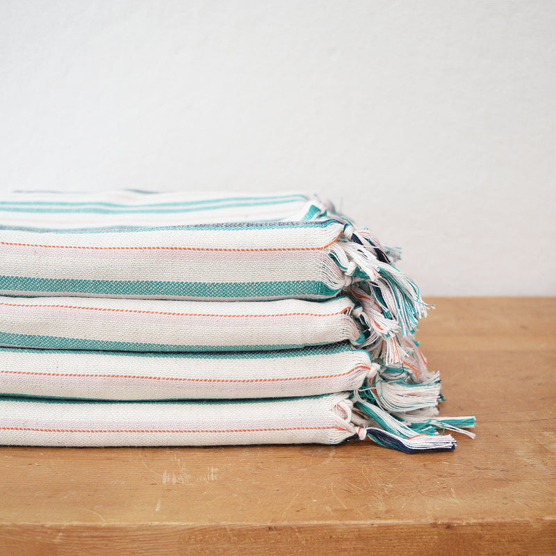 New Turkish towels in a linen cotton mix! Hand loomed  by skilled artisans in Turkey, Turkish towels/throws are known for their softness, durability and versatility. These feel a bit thicker than the regular cotton Turkish towels, which makes them perfect to use a light blanket or shawl.